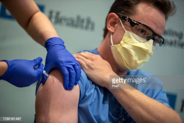 Respiratory therapy manager Matt Dartt gets an injection of the COVID-19 vaccine at Ronald Reagan UCLA Medical Center on December 16, 2020 in...