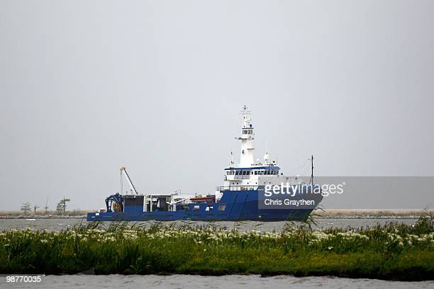 A responder boat sits anchored in the Mississippi River on the Lousiana Coast on April 30 2010 in Venice Louisiana Oil is still leaking out of the...