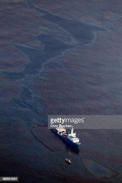 Responder boats skim oil off the surface of the water near the Deepwater Horizon wellhead on May 6 2010 in the Gulf of Mexico The well is still...