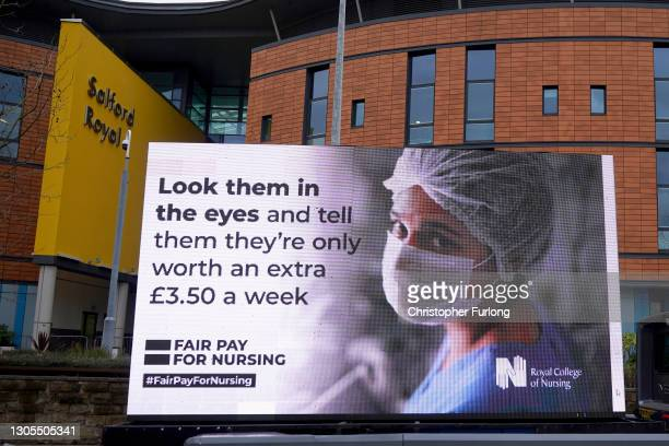 Responding to the government's NHS pay proposal, the Royal College of Nursing has released a digital billboard message showing the image of a nurse...