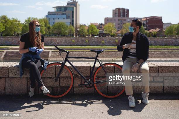 responsible couple spending time together by following the rule of two meters apart - corona sun stock pictures, royalty-free photos & images
