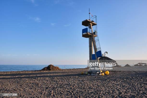 resque tower and bunches of garbage at the beach - finn bjurvoll stock-fotos und bilder