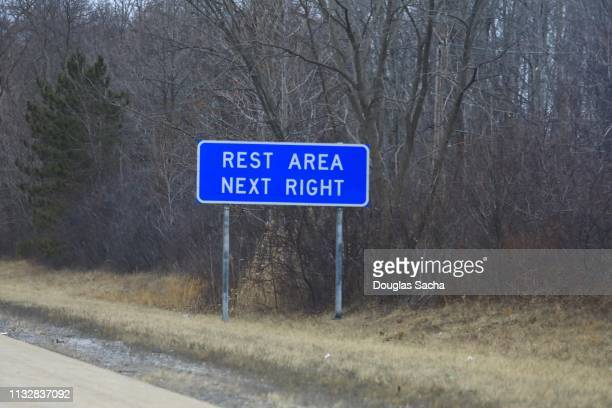 Rest area ahead notification sign off the highway