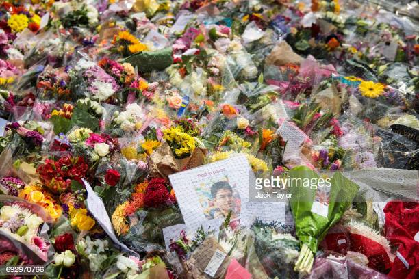 A 'Rest in Peace' sign sits among floral tributes on London Bridge following the June 3rd terror attack on June 6 2017 in London England Seven people...