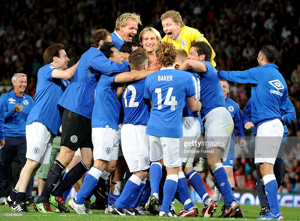 Rest Of The World team celebrate winning Soccer Aid in aid of UNICEF at Old Trafford on June 6, 2010 in Manchester, England.