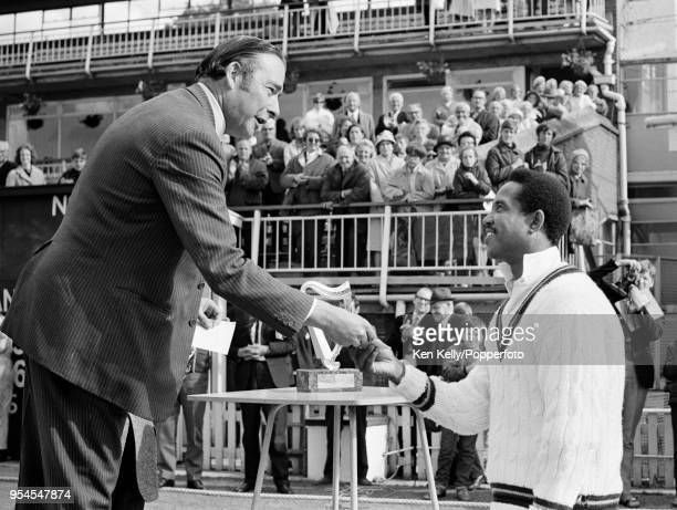 Rest of the World XI captain Garry Sobers is presented with the winner's cheque during the presentation ceremony after the 3rd match of the...
