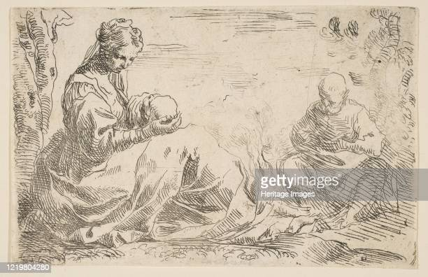 Rest on the flight into Egypt, Mary holding and looking at the infant Christ while St. Joseph reads, circa 1637. Artist Simone Cantarini.