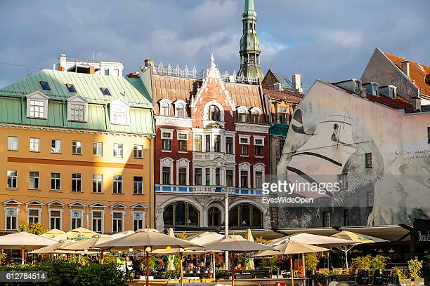 Restaurant and bar with people in the Old Town near St Peter's Church on September 02 2016 in Riga Latvia 'n