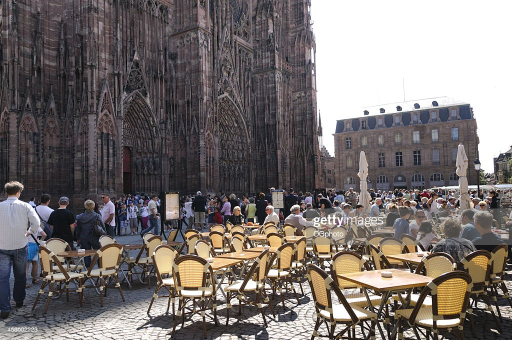 Restaurant and crowds in front of Strasbourg Cathedral : Stock Photo