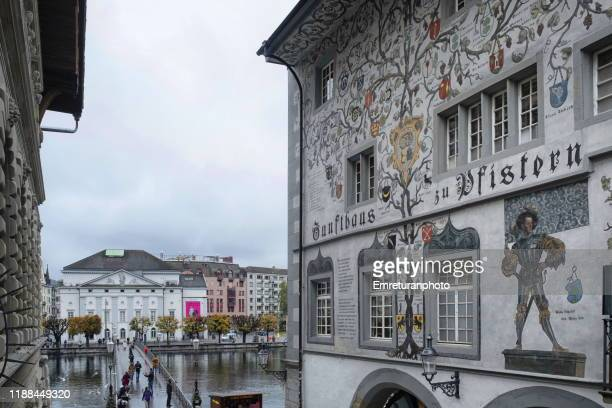 restaurant building facade and kapell bridge on the background in lucerne. - emreturanphoto stock-fotos und bilder