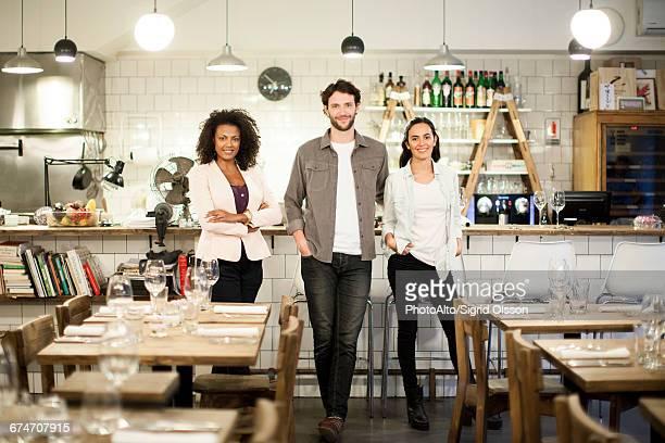 restaurant business partners, portrait - three people photos et images de collection