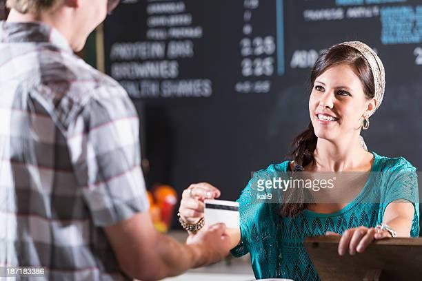 Restaurant cashier reaches for customer card
