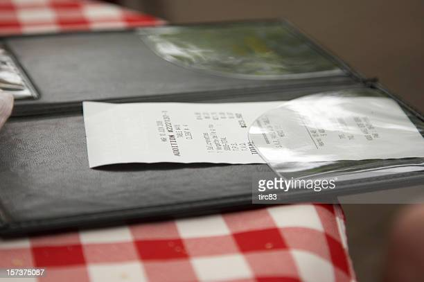 Restaurant check on patterned cloth