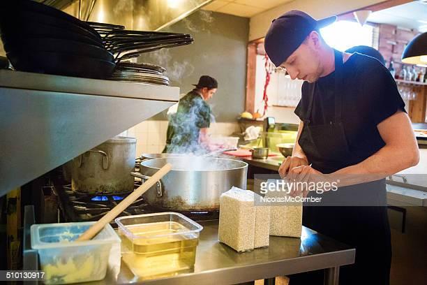 Restaurant cook preparing risotto