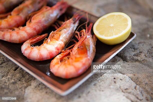 Restaurant dish of fresh shrimps and lemon, Mallorca, Spain
