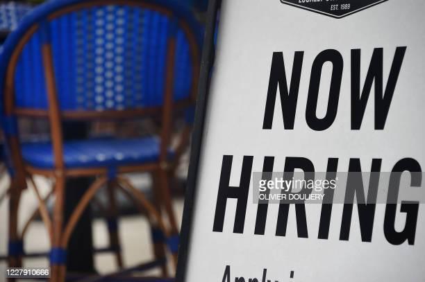 "Restaurant displays a ""Now Hiring"" sign amid the coronavirus pandemic, on August 4, 2020 in Arlington, Virginia."