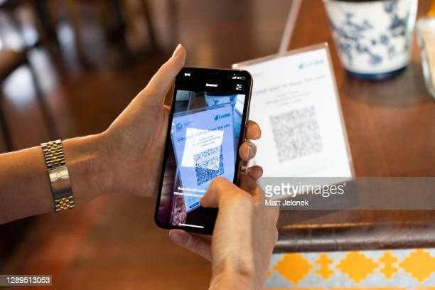 Restaurant guest scans a QR code using the SafeWA app on December 05, 2020 in Perth, Australia. From Saturday, people in Western Australia will need...