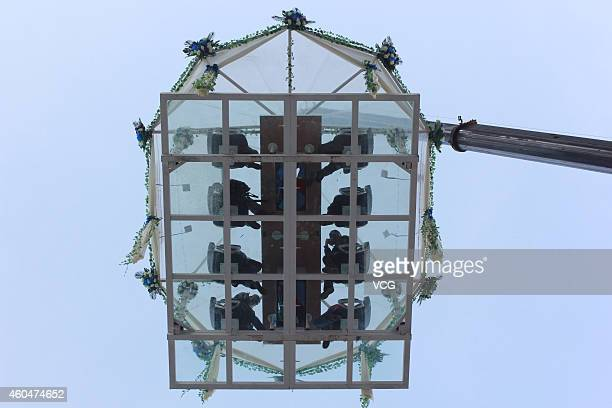 A restaurant hangs 30 meters in the air December 14 2014 in Wuhan Hubei province of China