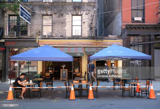 Restaurant in SoHo serves customers seated at sidewalk tables as the city moves into Phase 2 of re-opening following restrictions imposed to curb the...