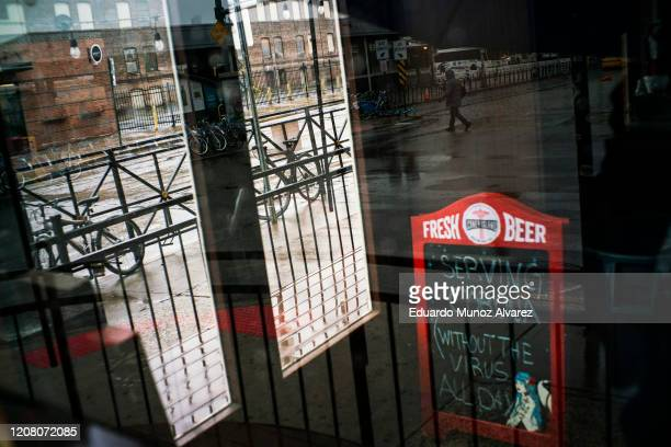 A restaurant is shown shuttered due to the coronavirus outbreak on March 23 2020 in Hoboken New Jersey There are now more than 30000 cases of COVID19...