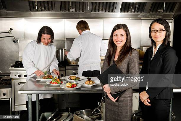 Restaurant manager with professional chefs working