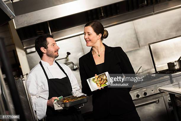Restaurant manager working with a professional chef