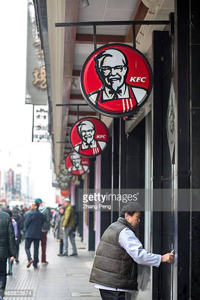 KFC restaurant on a walking business street KFC restaurants in China will start selling freshly ground coffee in 2015 to become a lowercost premium...