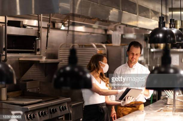 restaurant open after covid lockdown - manager stock pictures, royalty-free photos & images
