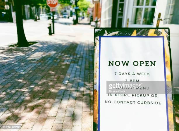 restaurant open signage in age of covid-19 - curbside pickup stock pictures, royalty-free photos & images