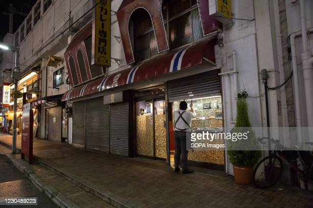 Restaurant owner closes his restaurant shortly before 8 pm. 2392 new Coronavirus cases were reported on January 8th 2021, the first day of the state...