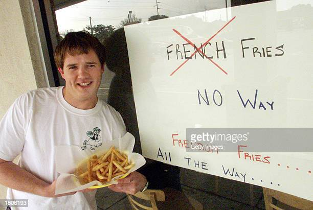 Restaurant owner Neal Rowland holds a plate of his Freedom Fries February 20 2003 in Beaufort North Carolina Rowland changed the name of the french...