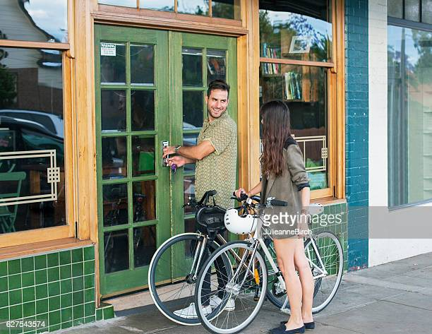 restaurant owner opening up his shop - opening event stock pictures, royalty-free photos & images