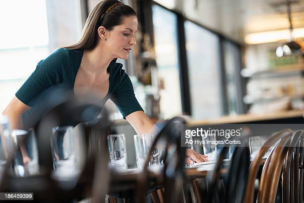 restaurant owner setting the table - putting stock pictures, royalty-free photos & images