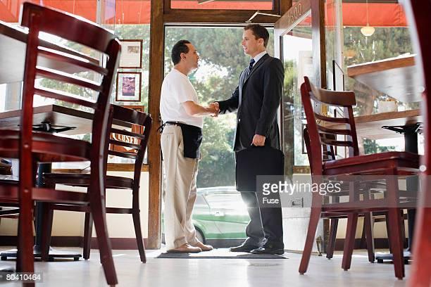 Restaurant Owner Shaking Accountant's Hand