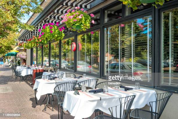 restaurant patio in downtown bend oregon usa - bend oregon stock photos and pictures
