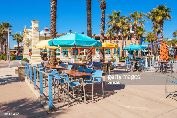 restaurant patio in pier park shopping district panama city beach florida - panama city beach stock pictures, royalty-free photos & images