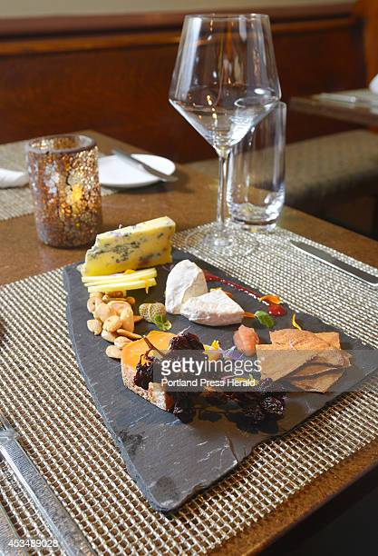 A restaurant review for Dine Out Maine Grace restaurant on Oak Street in Portland A cheese plate featuring Medalion Mimolette Asher Blue along with...
