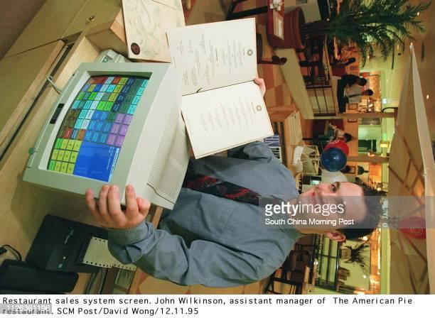 Restaurant sales system screen John Wilkinson assistant manager of The American Pie restaurant 12 Nov 95