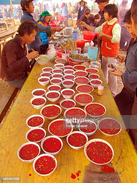 Restaurant serving Tiet canh at the market in Mèo Vac . Blood soup is made with raw blood of ducks or geese , with peanuts and herbs on top. This is...
