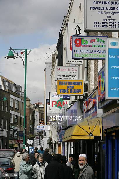 Restaurant signs seen in Brick Lane London Tuesday April 4 2006 Brick Lane the London street best known for its curries is now so infested with...
