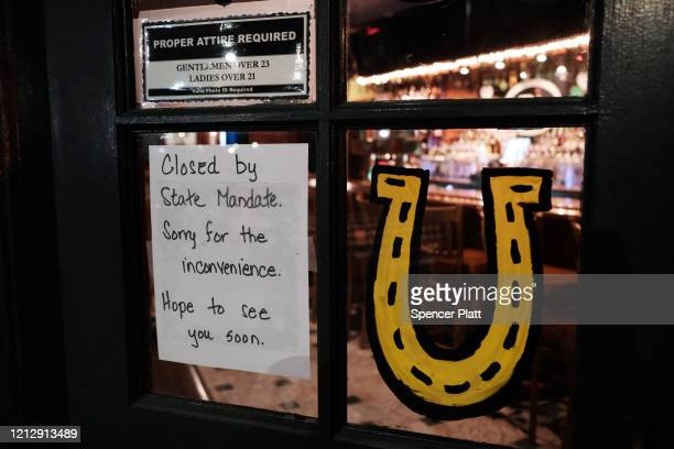 A restaurant sits closed in the early evening in Brooklyn after a decree that all bars and restaurants shutdown by 8 pm in New York City as much of...
