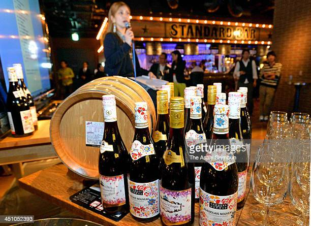 A restaurant staff prepare for the midnight release of the 2013 Beaujolais Nouveau vintage at a restaurant on November 20 2013 in Osaka Japan The...