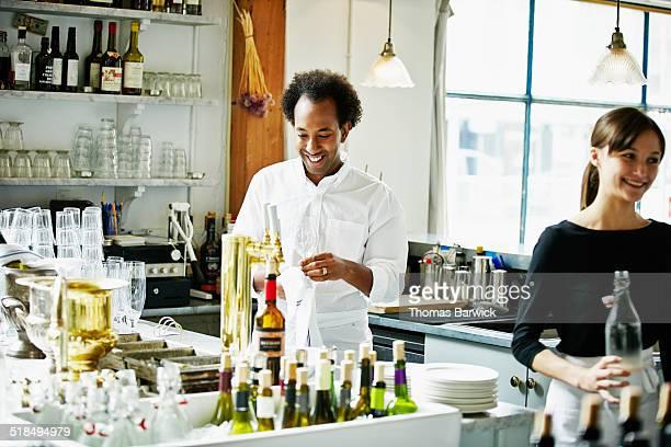 Restaurant staff preparing for dinner service