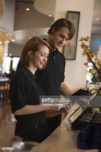 Restaurant staff reviewing menu