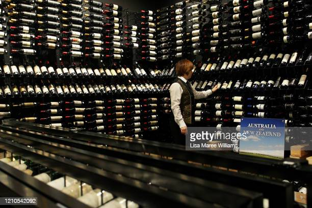 Restaurant Supervisor May Su oversees display in the wine cellar of award winning Golden Century Seafood Restaurant in Chinatown on March 05, 2020 in...