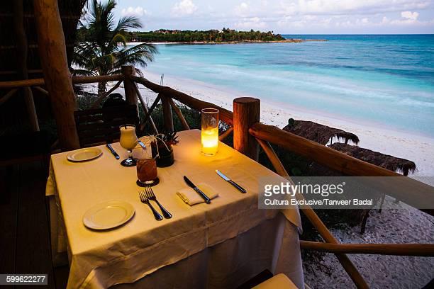 Restaurant table on beach, Tulum, Riviera Maya, Mexico