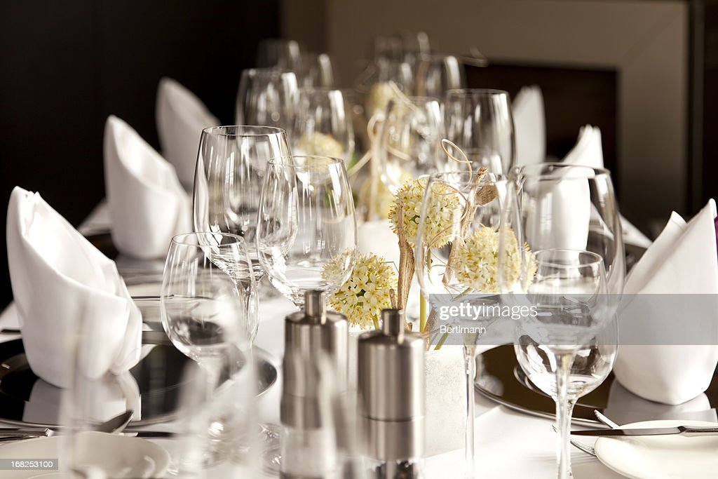A Restaurant Table Set At For Fancy Dinner : Stock Photo