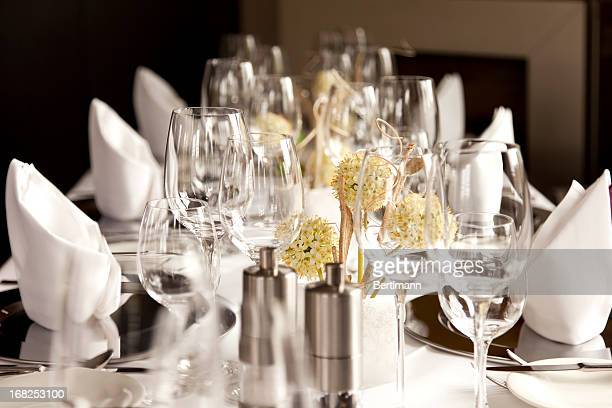 A restaurant table set at for fancy dinner