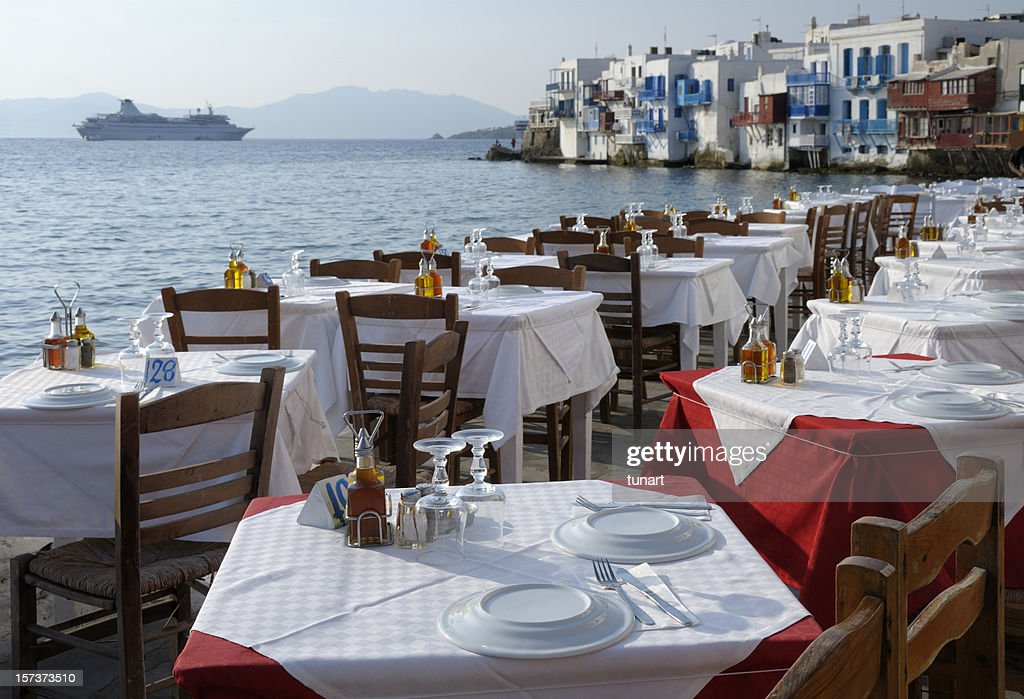 Restaurant Tables and Venetian houses in Mykonos, Greece : Stock Photo
