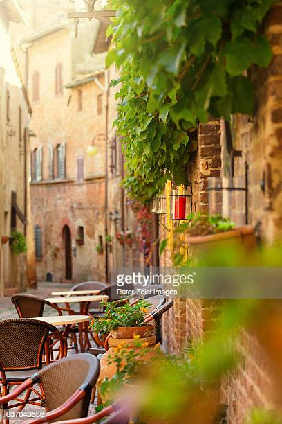 Restaurant tables in an old italian town in Tuscany, Italy